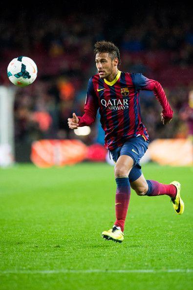 Neymar Santos Jr of FC Barcelona runs with the ball during the La Liga match between FC Barcelona and RC Celta de Vigo at Camp Nou on March 26, 2014 in Barcelona, Catalonia.