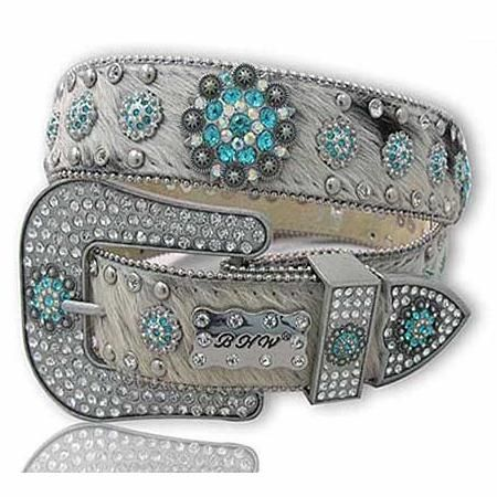 XXL Cowhide and Concho Women's Belt  The Western Boutique offers a wide selection of beautiful Texas style  Cowgirl Bling Belts. Made of genuine leather and cowhide.    These western belts feature Rhinestones, Crystals, Crosses, Conchos, and Pistols.  http://thewesternboutique.com/rhinestone-cowgirl-bling-western-belts.html