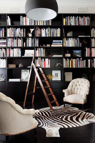 Black Library with zebra rug. Sebra teppe. http://www.sebraskinn.no