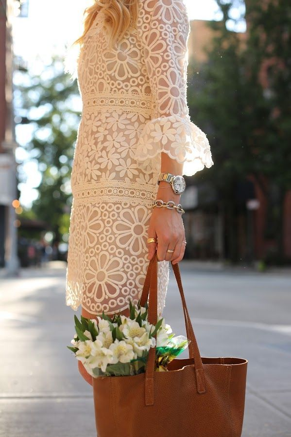 Gorgeous white lace print dress. Brown leather tote.