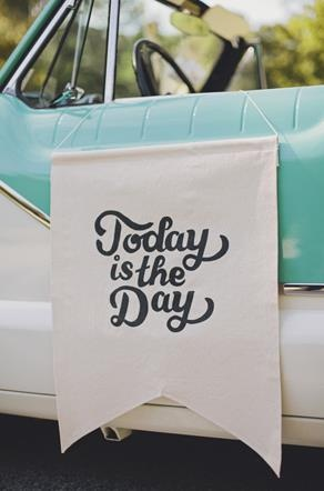 Love the classic care, in the minty aqua and the hanging banner! Getaway car…