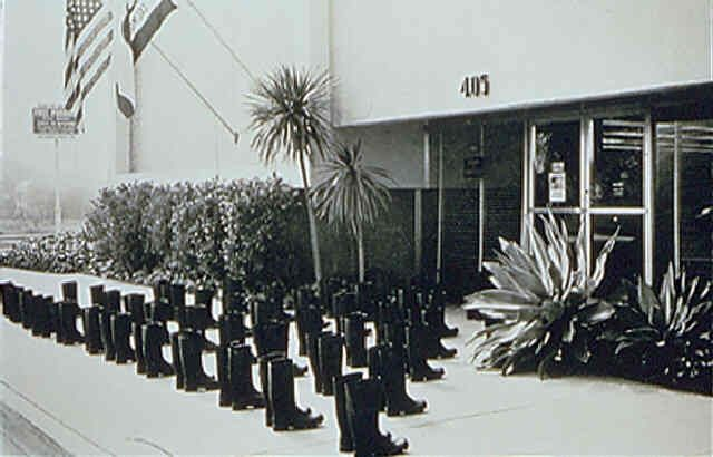 100 Boots At The Bank by Eleanor Antin