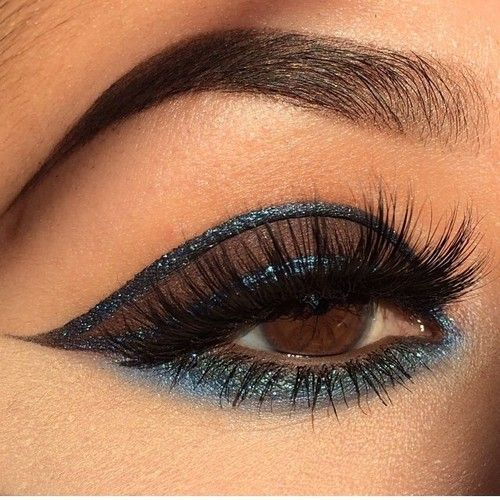 Matte Brown Eyeshadow Lined with Shimmer Blue Eyeliner ...
