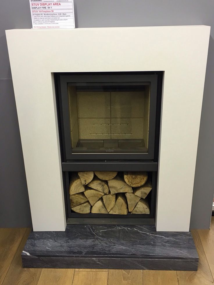 Stuv 16-Fireplace 58 Inset stove with integrated log store.