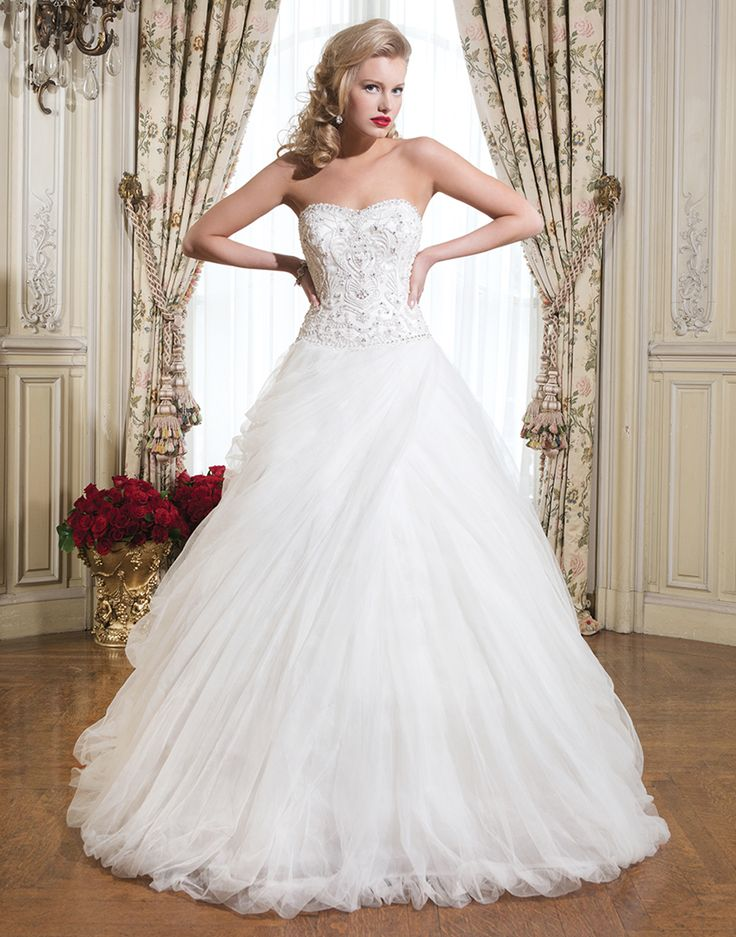 Simple Justin Alexander wedding dresses style Tulle beading over satin ball gown embellished with a strapless neckline The White Closet Bridal in Tampa FL