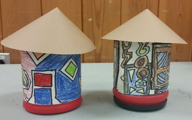 """Inspired by the houses painted by the Ndebele women of South Africa, students used coffee containers, brown craft paper and colored pencils to create their own.  """"Art Around the World"""" (ages 7--11)"""