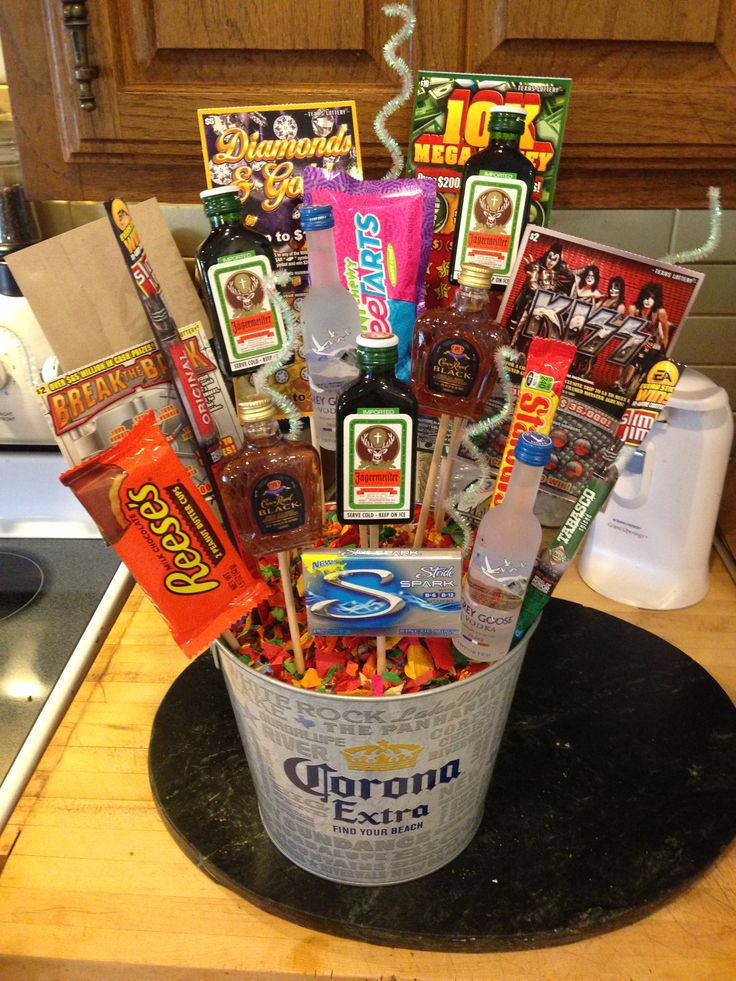 "Man Bouquet: I just recently made this for my boyfriend for his 25th birthday. It was super easy and fun to make. HE LOVED IT! I saw these bouquets all over the place with just alcohol or just candy but I decided to make it my own by adding all his favorite stuff. One of the things he said to me was ""you should put it on pintrest."" So I am, you will need: wooden dowels, floral foam, a glue gun, tape, a bucket or vase, confetti or tissue paper, glitter pipecleaners, and all your presents!"
