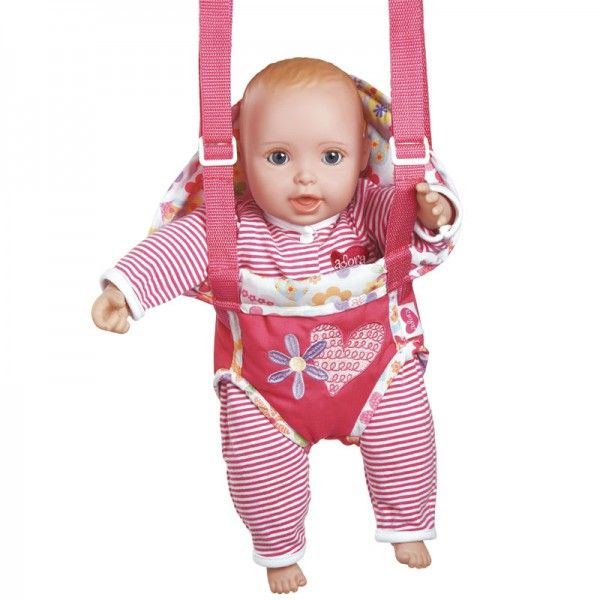 Deze babypop heeft mooie bruine ogen is lekker zacht. Hij heeft een pyjamaatje aan en ruikt naar babypoeder. Hij is 38 cm. groot. De pop heeft een lachmechanisme dat verwijderd kan worden en wordt geleverd met een draagzakje en een magnetisch speentje.Adviesleeftijd vanaf 2 jaar.