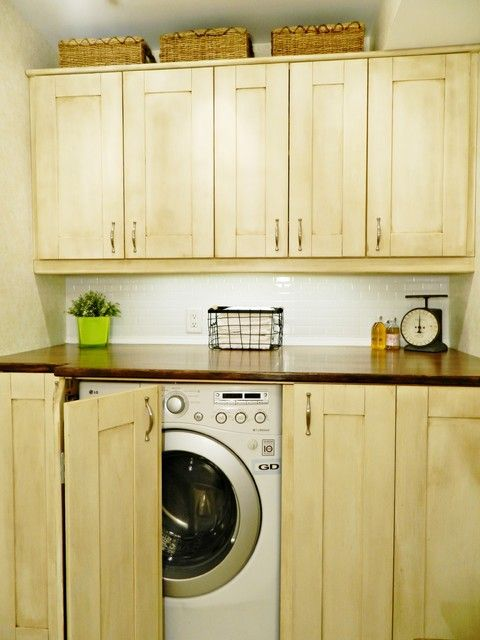 Like this laundry room the best. Maybe different wood tone. Adds more counter space and storage for laundry/cleaning products and place to hide router etc.