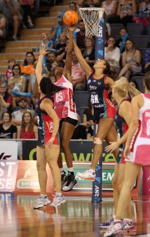 Determined: Thunderbirds goal shooter Carla Borrego tussles with Geva Mentor of the Vixens.