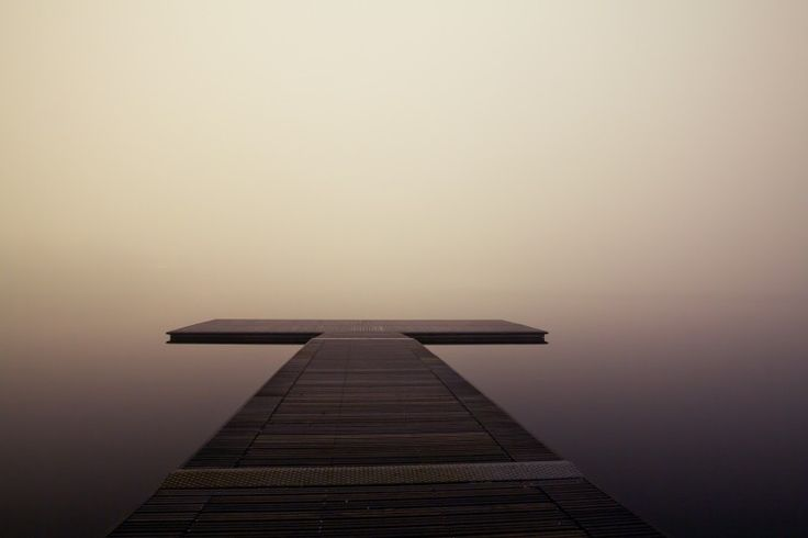Wooden pier in fog