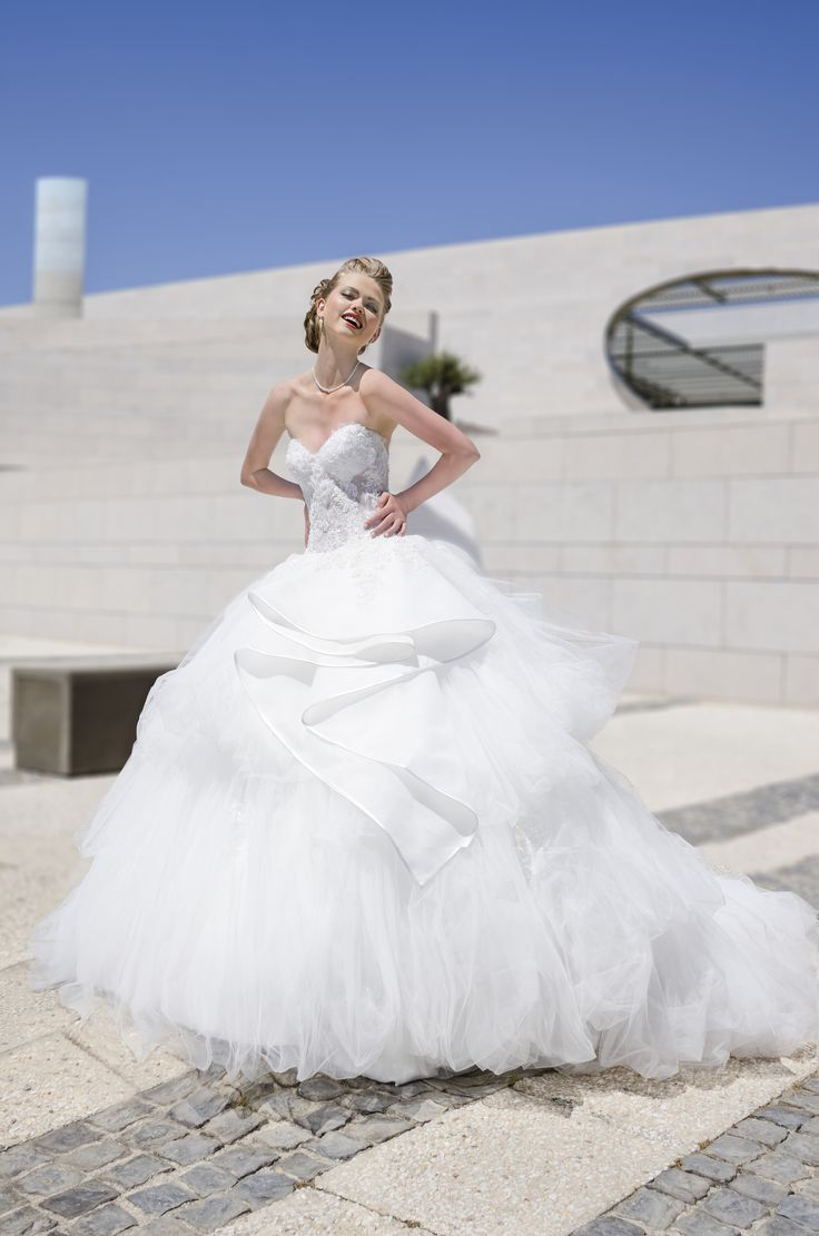 Amazing wedding dress with royal tulle and organza and beautiful beaded laces. www.mkarin.com