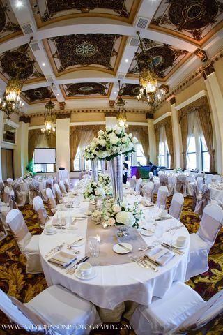 An elegant farmhouse style reception at The Pfister Hotel. Downtown Milwaukee Weddings.