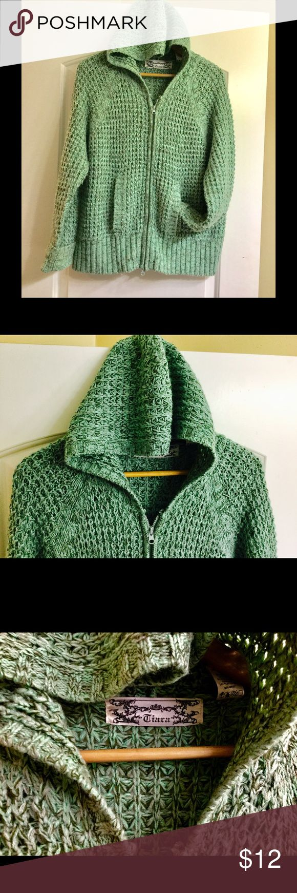 Light turquoise chunky knit zip up hoodie sweater Light turquoise chunky knit zip up hoodie sweater by Ciara This listing is for a light turquoise chunky knit zip up hoodie sweater by Ciara size xl fits large and medium if you like oversized sweaters, it is light turquoise mostly but there is light gray and like an olive green knitted into it as well very pretty and unique I wore this a couple times and every time I would wear it I would get compliments pictures do the sweater no justice…