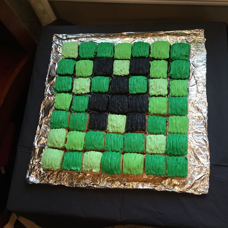 Minecraft creeper cake. I used a individual square brownie pan. Having cupcakes was so easy with the kids, no cutting and passing them out!