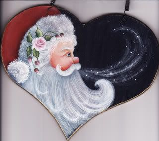 This good looking Santa even has pretty roses in his cap! Painted by ?????
