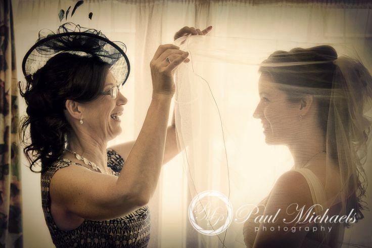 Mum helps the bride get ready. Wedding photography in Wellington, NZ. By PaulMichaels http://www.paulmichaels.co.nz/