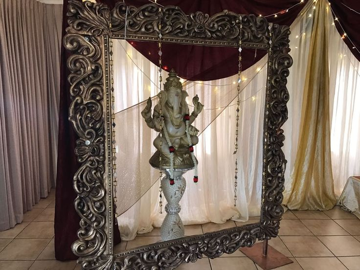 Monte Vista Venue stage decor used for a traditional gold and maroon hindu wedding.