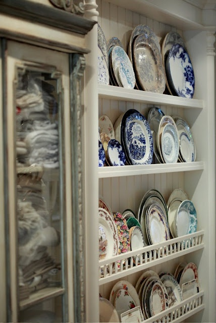 wonderful shelves to display an awesome collection of plates and cupboard with linens....from Colette's house.