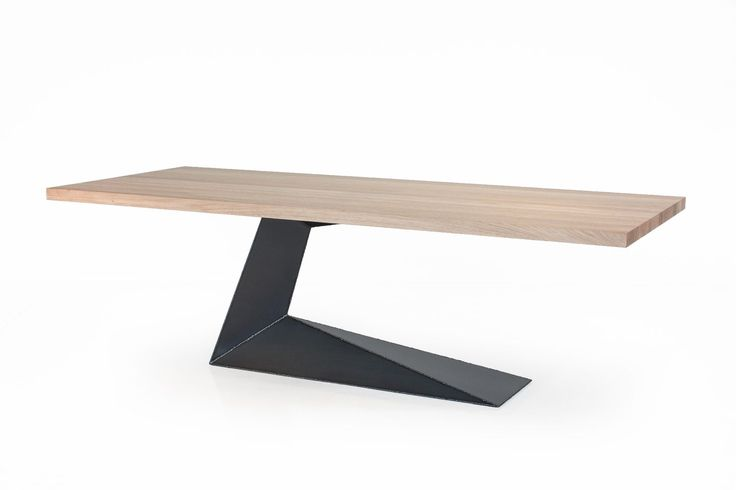 Table with top in solid wood having glued boards with squared edges, characterised by a leg with great lightness and stability while at the same time emphasising the state of suspension of the top.The leg is made of iron with visible welding.Finish: base of oil / natural wax of vegetable origin with pine extracts.