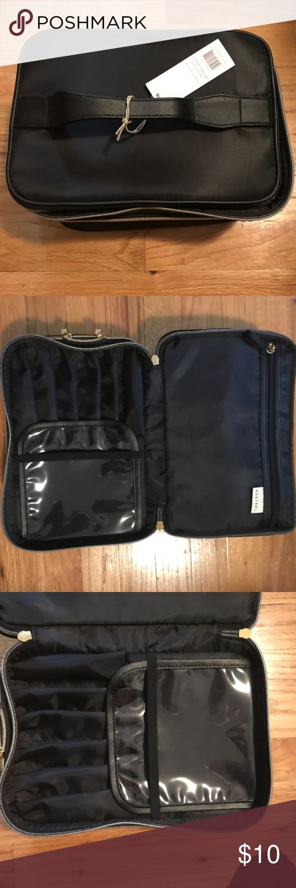 """Makeup Carrying Bag Black💄👛 Black makeup carrying bag (case) with gold toned hardware. Case zippers open in two tiers: the first has an hug internal zipper pouch on one side and on the other side, fitted slots for makeup brushes, lip or eye pencils, shadow sticks—anything in a long tube. A clear plastic piece covers the tops of the """"brush holders"""" and is also a pouch. The next tier zippers open to a roomy case for lose makeup and toiletries. New with tags and never used!! 👛💄 Kestrel Bags…"""