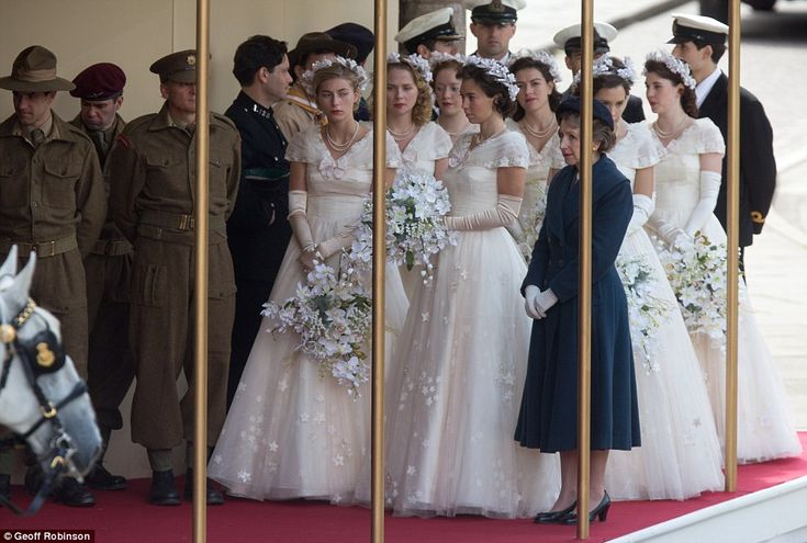 Bridesmaids waiting for Queen Elizabeth II hold pale bouquets and floral headbands as filming takes place inCambridgeshire today for the new Netflix drama The Crown
