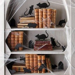 rat and mice silhouettes on the books