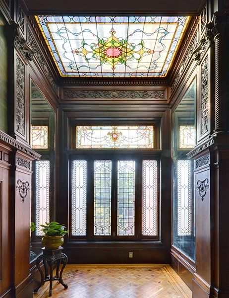 The interiors feature exquisite original details, including coffered ceilings, inlaid parquet flooring, wood paneling, hand-painted frescoes and murals, and stained-glass accent windows.