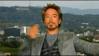 robert downey jr blow kiss mwah blowing kisses GIF