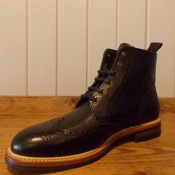 John White Bourton Black Brogue Boots: These Bourton black brogue boots are practical yet fashionable.  Six eyelet brogue boot, grain leather upper, leather lining, studded rubber sole.