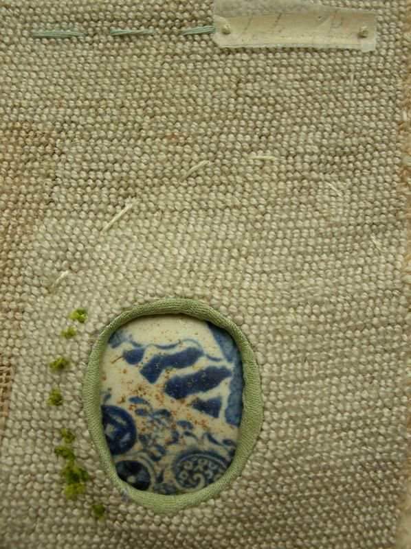 "Part of the River Wall series by textile artist Hannah Lamb, the work inspired by walks along a local river.  I was drawn to her use of a found piece of china to ""patch"" her work.  She later also work on the visible mending and darning theme."