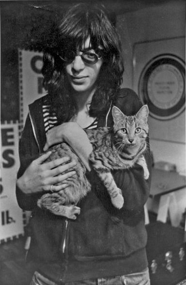 Joey Ramone and a really beautiful cat. I think this is my favourite picture of Joey, such a sweet man, and so sad he's gone.