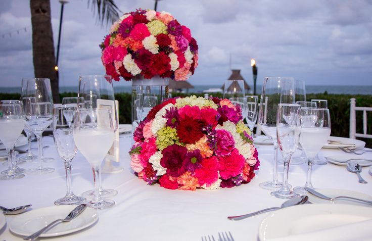 Loving the combination of height and color with the centerpieces for a reception here at Zöetry Paraiso de la Bonita! #WeddingFlowers #ReceptionDecor #FloralCenterpieces