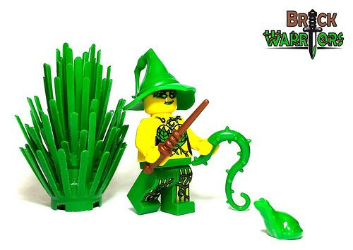 The Witch - New Vine Whip!  There's no way that this frog can win the fight.  A vine whip and a wand?  This custom Lego witch minifigure is unstoppable.  Hop away little foggy, hop away! #Lego #Minifigure #BrickWarriors #vine #whip #witch #accessories #hat #wand #frog #green #wizard #spell #minifig #harrypotter #magic #magician