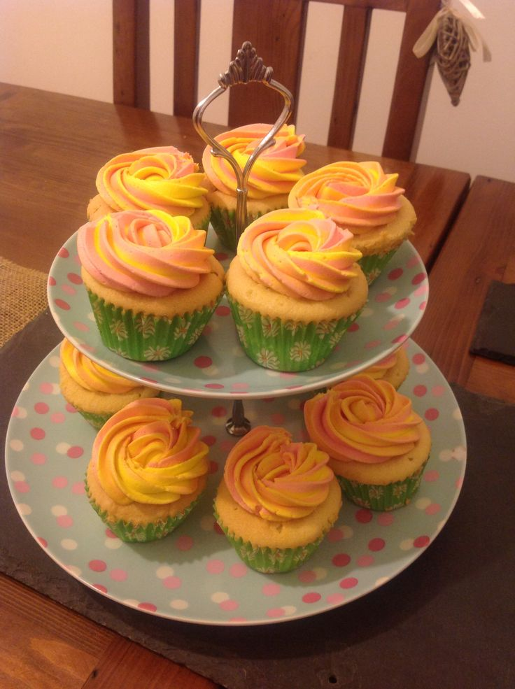 Rose topped pink and yellow swirled cupcakes