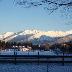 Farm in Terrace, BC with snowy mountains