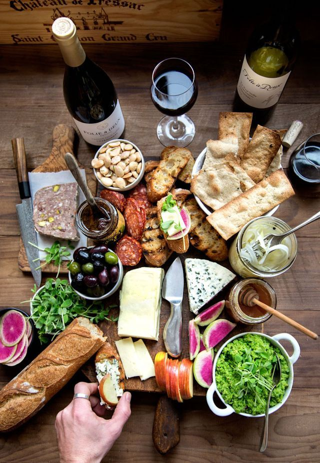 Follow: Feasting at Home There are few things better than lots of cheese for dinner. There is also nothing easier than creating a cheese spread with lots of accompaniments to satisfy a group of guests