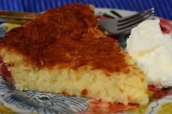 Impossible Coconut Pie has a soft bottom crust, a custard-like filling, and a deliciously crispy coconut topping. From Joyofbaking.com With Demo Video
