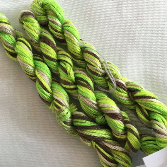 This is my hand dyed thread in the colourway Orchard on 8m Anchor six stranded floss for cross stitch or embroidery, or other needlework.  Orchard