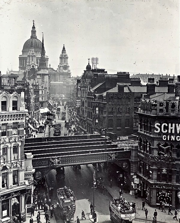 Ludgate Hill, City of London; showing the long departed railway bridge. This was replaced by the Snow HIll tunnel taking the Thameslink line from Farringdon to Blackfriars under rather than over Ludgate Hill, revealing the view of St. Pauls in background.