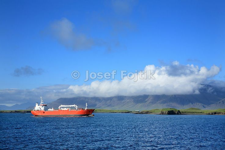 A cargo ship comming to Reykjavik with the Kistufel Mountain in the background, Iceland