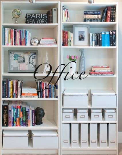 Books stylishly arranged on shelves with a mix of boxes and magazine organisers.