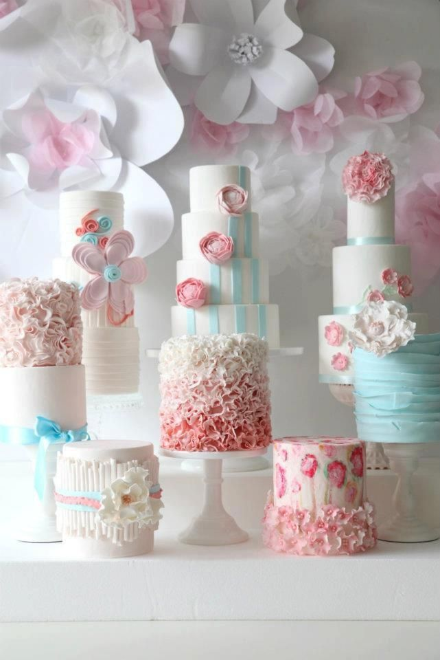 Really like the idea of a deconstructed wedding cake table with different designs / flavors but color uniting the presentation
