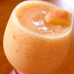 "Grandmother's Peach Fuzz | ""Limeade, rum and fresh peaches blend into a velvety summer drink. It cannot be made virgin, the rum is the key ingredient! The peach skins add a lovely bit of color. Canned peaches do not work as well."" (oooh. looks yummy.)"