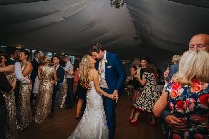 When it feels like it's just you and her/him and no one else in the room... I love how focussed these two are on each other with their loved ones all around them. Photo by Benjamin Stuart Photography #weddingphotography #firstdance #brideandgroom #groupphoto #couplesdancing #weddingday