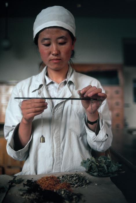 China. Preparing herbal medicine for impotency. 1979 by Eve Arnold