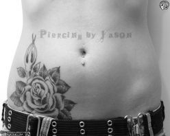 rose tattoo and lower naval piercing