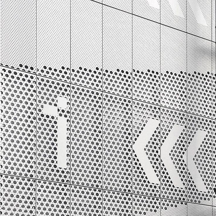 Supergraphic wayfinding in perforated aluminium @hereeast