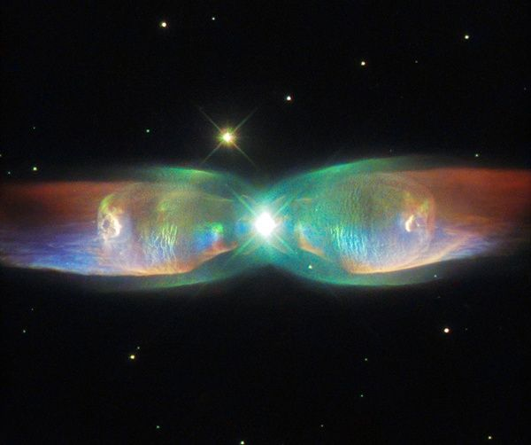 The Twin Jet Nebula (PN M2-9) is a striking example of a bipolar planetary nebula. Bipolar planetary nebulae are formed when the central object is not a single star but a binary system. Studies have shown that the nebula's size increases with time, and measurements of this rate of increase suggest that the stellar outburst that formed the lobes occurred just 1,200 years ago. ESA/Hubble & NASA; Acknowledgement: Judy Schmidt