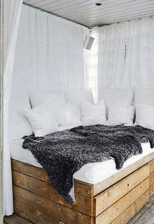 Maybe a corner bed with drawers built in? Then curtain rails on the ceiling to on the sides not against the wall?